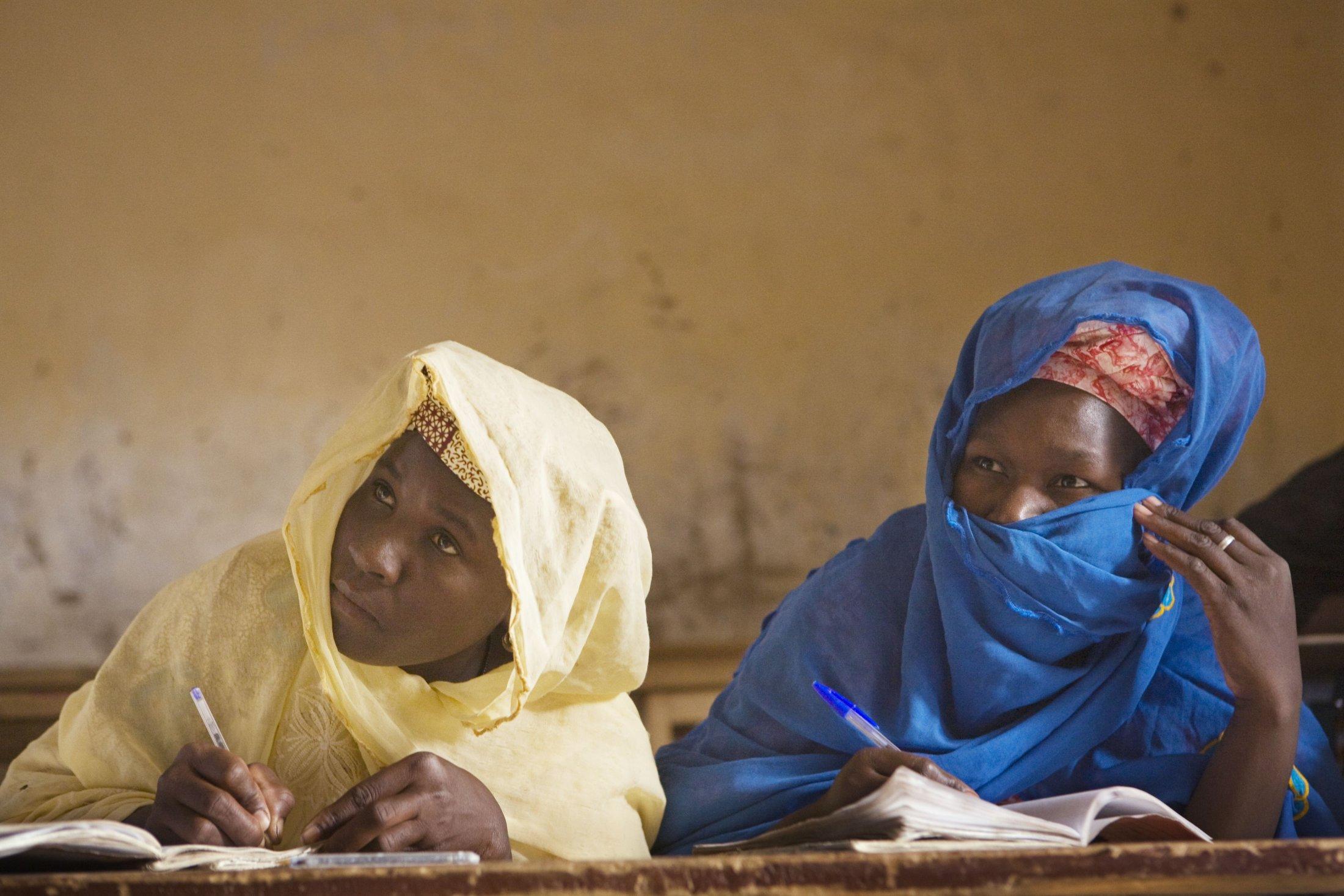 Mohamed Hatim teaches women Arabic in the classroom of his medersa.